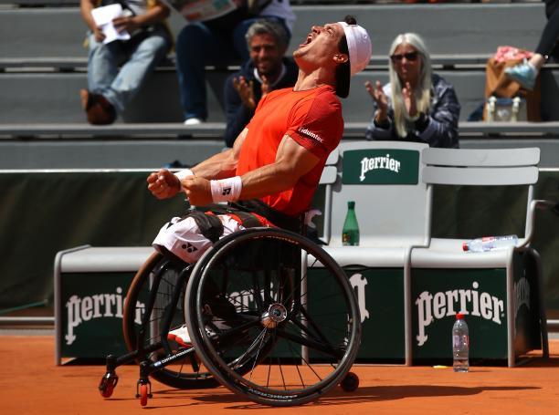 Argentinian wheelchair tennis player Gustavo Fernandez celebrates screaming at the sky after winning Roland Garros