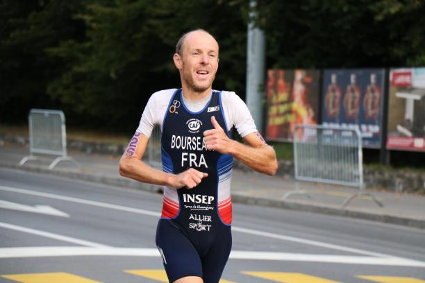 Yannick Bourseaux exhausted running to the finish line