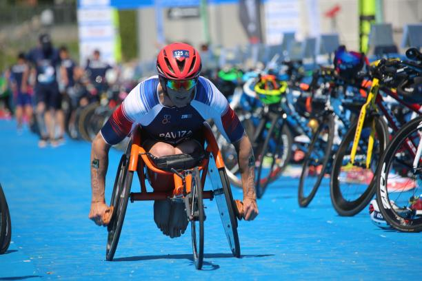 A male Para triathlete in a wheelchair race