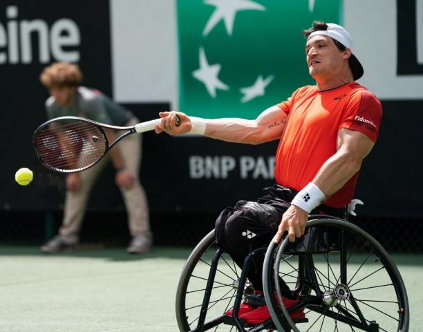 Argentinian wheelchair tennis player Gustavo Fernandez hits a forehand