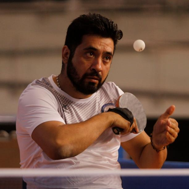 Chilean table tennis player Luis Flores serving