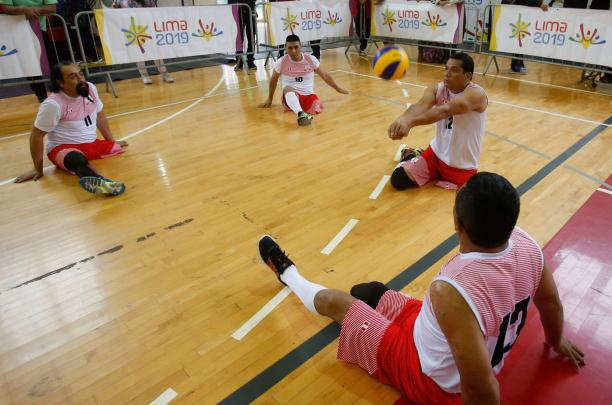 Peruvian sitting volleyball player Bruno Jose Quiros Davalos hits the ball