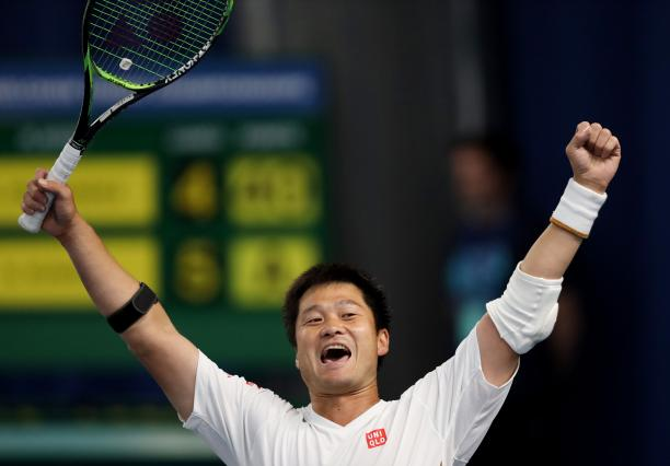 Japanese wheelchair tennis player Shingo Kunieda lifts his arms after winning the final
