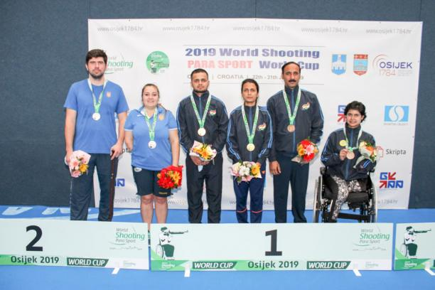 Ukrainian and Indian shooting Para sport athletes pose on the podium