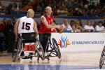 A picture of a person in a wheelchair playing basketball