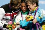 L-R) Silver medallist Cigdem Dede of Turkey, gold medallist Ivory Nwokorie of Nigeria and bronze medallist Lidiia Soloviova of Ukraine console each other on the podium during the medal ceremony for the women's