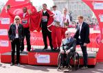 VI class medallists celebrate the first IPC Athletics Marathon World Cup