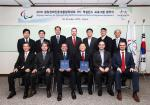 Members of the IPC and PyeongChang2018 Organising Committee celebrate the signing of the 2018 Excellence Programme