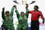 Three heavyweight female powerlifters on the podium at Glasgow 2014.