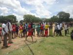 A young Ugandan tries out shot-put