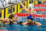 Two swimmers smile at each other after competing at the 2014 IPC Swimming European Championships