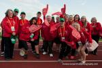 Some volunteers at the Swansea 2014 IPC Athletics World Championships pose for a photo.