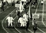 A picture of wheelchair athletes parade