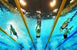 A picture of three men underwater
