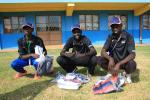 Three Kenyans opening welcome packs