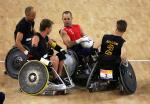 A picture of four wheelchair rugby players.