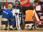 A picture of a man on an electric wheelchair playing Boccia.