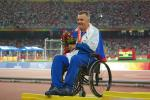 A picture of a man in a wheelchair during a medal ceremony
