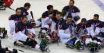 US players in their sledges on the ice after winning against Russia.