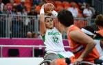 women in wheelchair saves the basketball