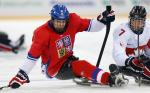 Man on hockey sledge focusing on the puk