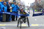 Tatyana McFadden of the United States crosses the finish line to win the women's push rim wheelchair division of the 119th Boston Marathon on April 20, 2015 in Boston, Massachusetts.