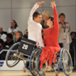 Athletes practicing wheelchair dance sport.