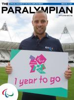 Cover photo of the magazine Paralympian with a picture of Oscar Pistorius holding a poster with London 2012 logo and text One year to go.