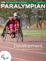 Cover photo of the magazine Paralympian showing athlete in a wheelchair with the text: Development, growing the paralympic movement.