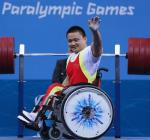Liu Lei of China celebrates a world record lift and takes gold in the Men's 67.5kg competition at the London 2012 Paralympic Games.