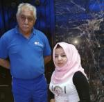 Zahraa Al-Maliki with her coach.