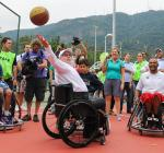 IPC president Sir Philip, a five-time Paralympian in wheelchair basketball, shows them how it's done.