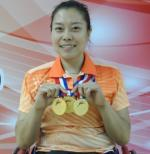 Woman holding medals