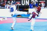 Two athletes doing taekwondo