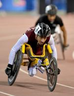 Man in racing wheelchair on track