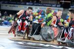 Wheelchair rugby players in action