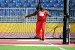 Man in red jersey throwing a discus