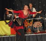 A wheelchair dancer is held aloft during a dance