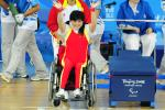 A Chinese powerlifter celebrates winning gold in powerlifting at her home Paralympic Games.