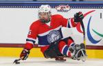 Thomas Jacobsen of Norway competes at the 2015 IPC Ice Sledge Hockey World Championships A-Pool in Buffalo, USA.