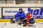 Two ice sledge hockey players in action