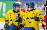 Per Kasperi celebrating with his teammate in the game against Austria at the 2015 IPC Ice Sledge Hockey World Championships B-Pool in Ostersund, Sweden.