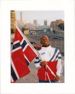 Athlete holding the Norwegian flag.