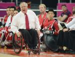 Wheelchair rugby coach in wheelchair yells instructions