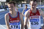 Upper bodies of two men in Russian jerseays on a track