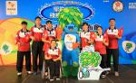 Seven athletes posing with Rio 2016 Tom mascot