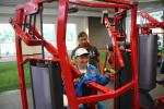 Woman in wheelchair tries out arm exercise machine