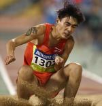 Guangxu Shang of China competes in the men's long jump T37.