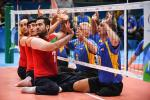 Sadegh Bigdeli of Iran, Petro Ostrynskyi and Sergii Shevchenko of Ukraine compete during Mens Sitting Volleyball match between Iran and Ukraine at the Rio 2016 Paralympic Games.