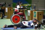 Women in a wheelchair doing para sport shooting